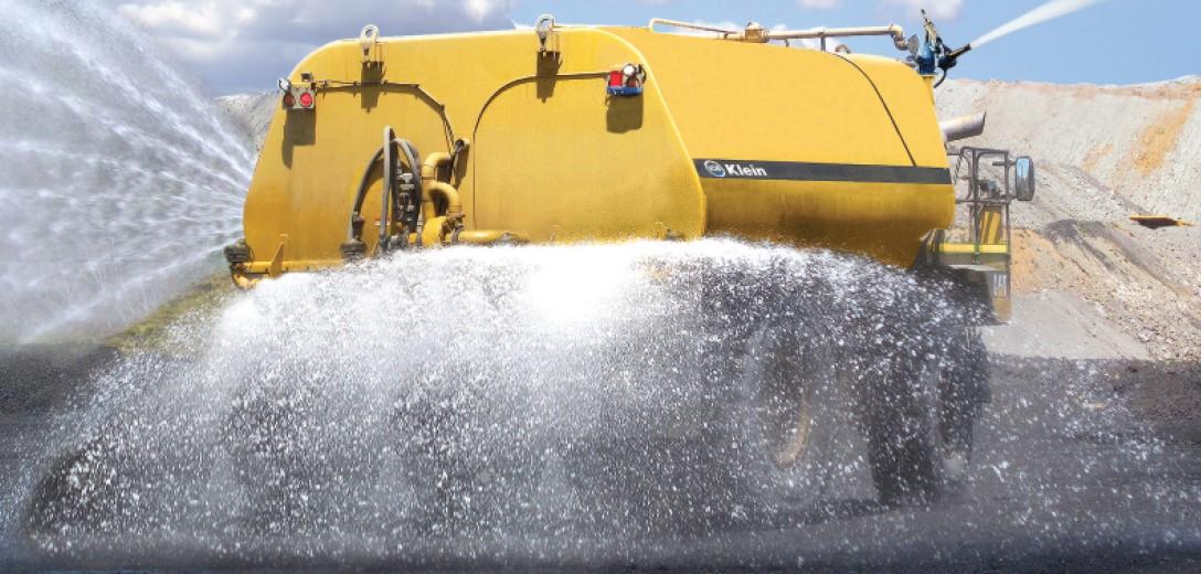 Yellow truck irrigating