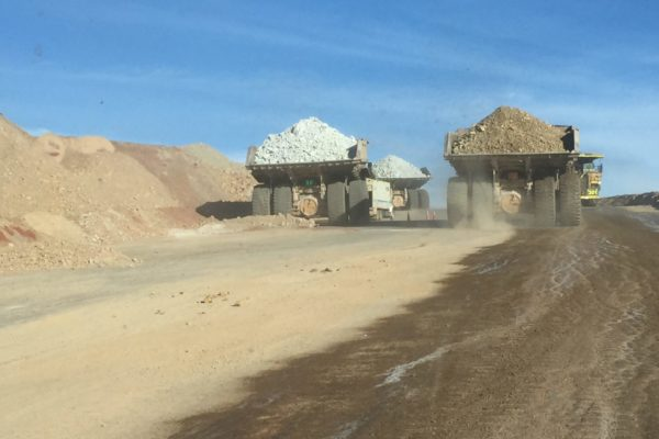 dump trucks carrying soil
