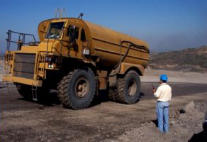 truck and a worker on a mining site