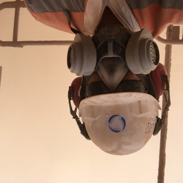 abc dust worker wearing a gas mask